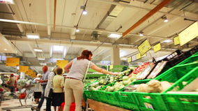 Interior of ordinary grocery section with customers stock video footage
