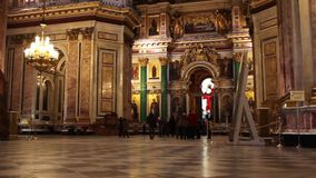 Interior of ornate the temple. Interior St. Isaac's Cathedral Museum St. Petersburg Russia  zoom out stock video footage