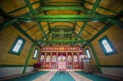 Interior of orthodox wooden church Stock Image