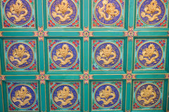 Interior painting of golden dragon on the ceiling stock image