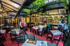 Interior with paintings on restaurant walls. Street Skadarlija, Royalty Free Stock Photography