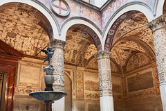 Interior of Palazzo Vecchio, Florence, Italy. Interior of Palazzo Vecchio (Old Palace), in Florence, Italy, with antique frescoes and the fountain with the Stock Images