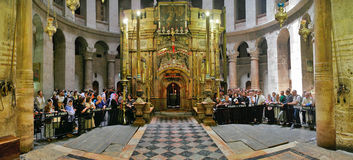 Interior panorama of Church of the Holy Sepulchre in Jerusalem,. JERUSALEM - APRIL 23: Interior panorama of Church of the Holy Sepulchre with congregation and Stock Photos