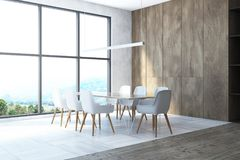 Panoramic dining room interior. Interior of a panoramic dining room with large windows, a tiled floor and a long wooden table surrounded by white chairs. 3d Royalty Free Stock Photo