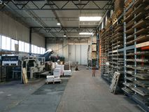 Interior of a paper and cardboard factory, die-cutting department. Packaging. Forklift stock photo