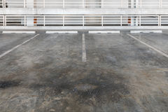 Interior of parking garage with car and vacant parking lot Royalty Free Stock Image