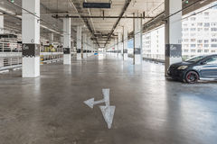 Interior of parking garage with car and vacant parking lot Stock Photography