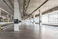 Interior of parking garage with car and vacant parking lot Stock Images