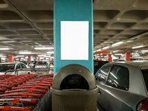 Interior Parking Lot Advertisement Mockup Shopping Carts Parked Cars Trash Bin stock image