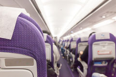 Interior of passenger airplane and aisle on plane. Stock Photos