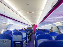 Interior of passenger airplane. With people on seats Royalty Free Stock Photos