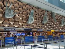 Interior of passenger arrival check-in counters at Indira Gandhi International Airport royalty free stock image