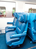 Interior of a passenger train with empty seats Stock Photos