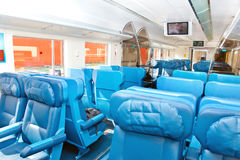 Interior of a passenger train with empty seats Royalty Free Stock Photo