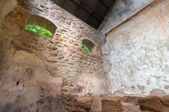Abandoned Prison in Salvation& x27;s Islands, French Guiana. Interior of a penal colony at Ile Royale, one of the islands of Iles du Salut & x28;Islands of Stock Image