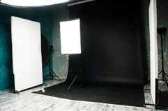 The interior of the photo studio. Preparing to work with photographic equipment. Black cyclorama, exposure to light on the octobox