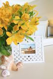 Interior picture frame with flowers Stock Images