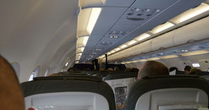 Interior of a plane during take off stock video footage