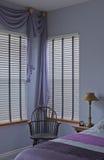 Interior of plum purple bedroom with windows Stock Photos