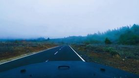 Travel by car inside view on mountains with clouds. Interior point of view od off road car traveling and driving at the mountains in Tenerife. Clouds and stock footage