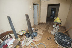 Interior of poor African house following flooding disaster. Interior of a poor African slum house showing devastation following a major flooding natural disaster Stock Photo