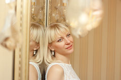 Interior portrait of pretty blond girl Royalty Free Stock Photo