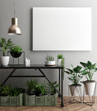 Interior poster mock-up with empty frame and plants in the room. Stock Image