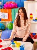 Interior of  preschool  kindergarten with teacher. Interior of game room in preschool  kindergarten with teacher Stock Image