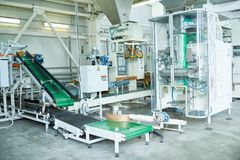 Power Units at Food Factory. Interior of production workshop at food factory, group of modern assembly line units , copy space stock image