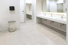 Interior of public clean toilet in shared toilet there is a wide selection of sinks with mirrors Stock Images