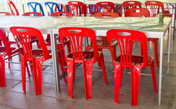 Interior of public dining area with colourul plastic chairs and tables Stock Photo