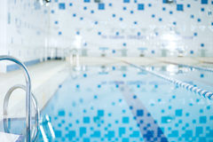 Interior of public indoor swimming pool Royalty Free Stock Photos