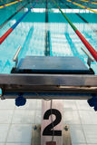 Interior of public indoor swimming pool with racing Lanes and bl Royalty Free Stock Photography