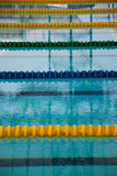 Interior of public indoor swimming pool with racing Lanes and bl Stock Image