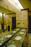 Interior of a Public Restroom. The interior of a public bathroom with sinks, mirrors and urinals Stock Photo