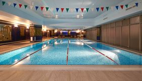 Interior of public swimming pool in a luxury fitness gym.  Stock Photos