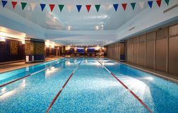 Interior of public swimming pool in a luxury fitness gym.  Royalty Free Stock Photos