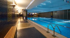 Interior of public swimming pool in a luxury fitness gym.  Stock Image