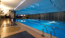 Interior of public swimming pool in a luxury fitness gym.  Stock Photography