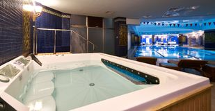 Interior of public swimming pool in a luxury fitness gym.  Royalty Free Stock Images