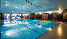 Interior of public swimming pool in a luxury fitness gym.  Royalty Free Stock Image