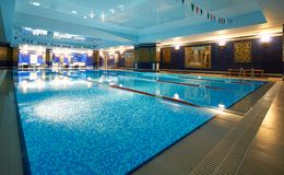 Interior of public swimming pool in a luxury fitness gym.  Stock Images