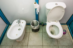 Interior public toilet cabins with WC and bidet Stock Photography