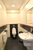 Interior of a public toilet in light tones Royalty Free Stock Photo