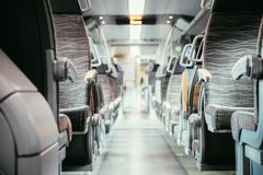Interior of a public transport train, empty seats. Interior of a public transport train, blurry background bus commuting subway journey travel seats empty nobody royalty free stock images