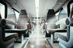 Interior of a public transport train, empty seats. Interior of a public transport train, blurry background bus commuting subway journey travel seats empty nobody stock photography