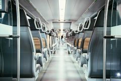 Interior of a public transport train, empty seats. Interior of a public transport train, blurry background bus commuting subway journey travel seats empty nobody royalty free stock photography