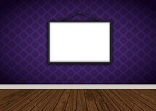 Interior with purple damask wallpaper with blank picture frame. Room interior with purple damask wallpaper, blank picture frame and wooden floor Stock Images