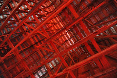Interior Rafters of a Barn. Red beams and rafters inside a large barn in Maine stock photography