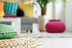 Interior with rattan cushion. Pink and green pouf, close up stock photos